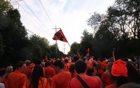 Students walk to Carmel before first football game