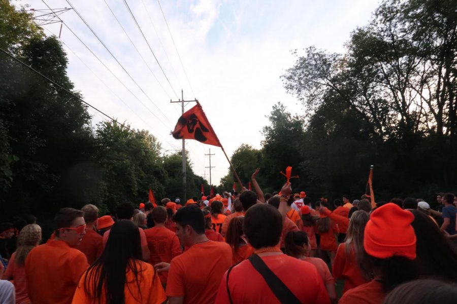 The majority of the student section radiated their school spirit for the orange-themed football game.