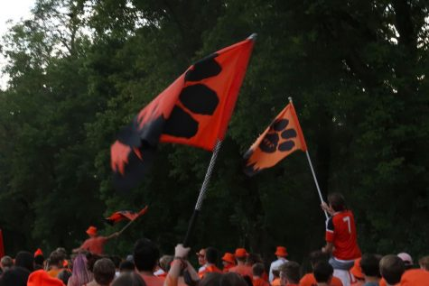 Several students waved Wildcat flags toward the end of the march.