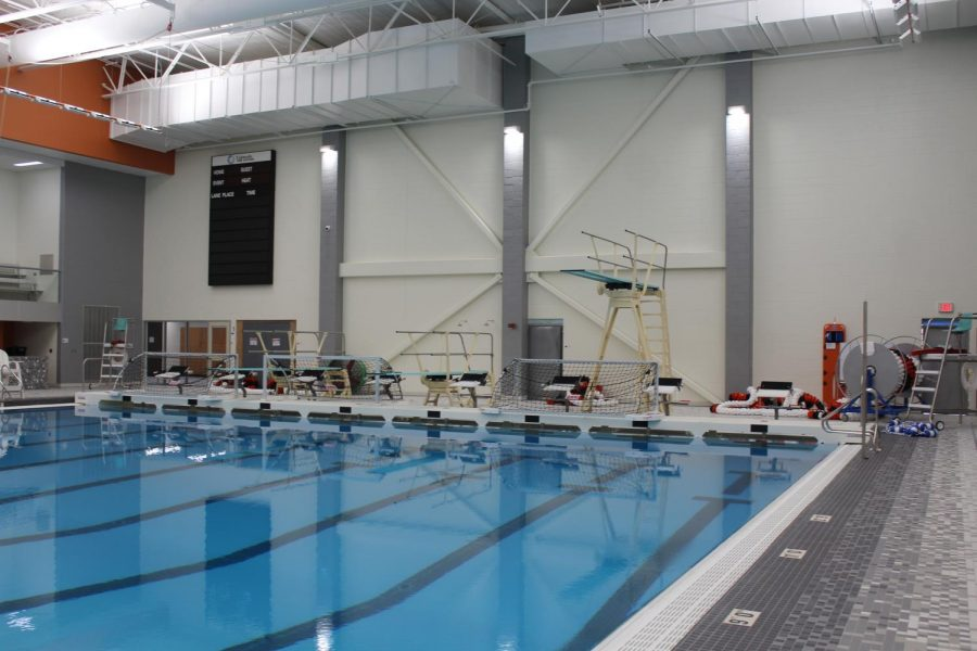 With the diving boards in a separate section of the pool as the main lanes, more events can be run simultaneously at swim meets when the divider is put in the middle of the pool.