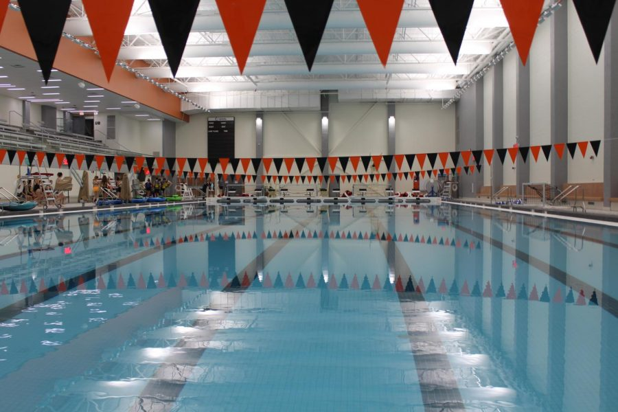 Three black and orange banners span the eight lanes that the new pool boasts.
