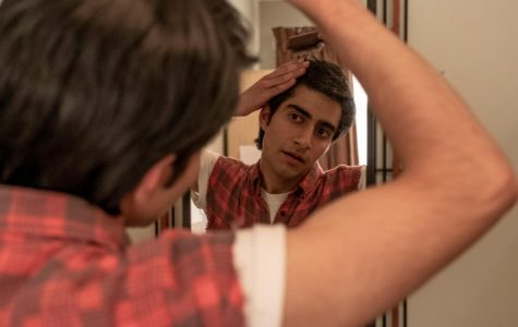 "Viveik Kalra in ""Blinded by the Light,"" styling himself after his hero Bruce Springsteen (Nick Wall/Warner Bros.)"