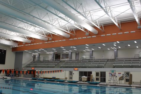 The new elevated viewing section of the pool which includes a back on the bleachers spans larger than the other pool and offers more viewing space and increased ways to enter and exit including an elevator.