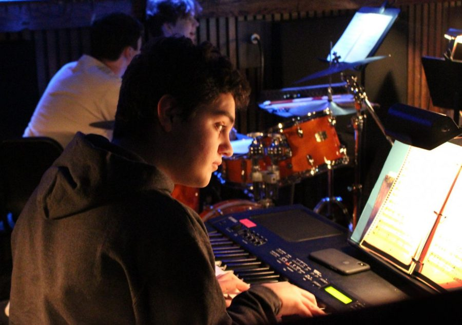 Junior Sebastian Ingino plays the keyboard in the pit orchestra.