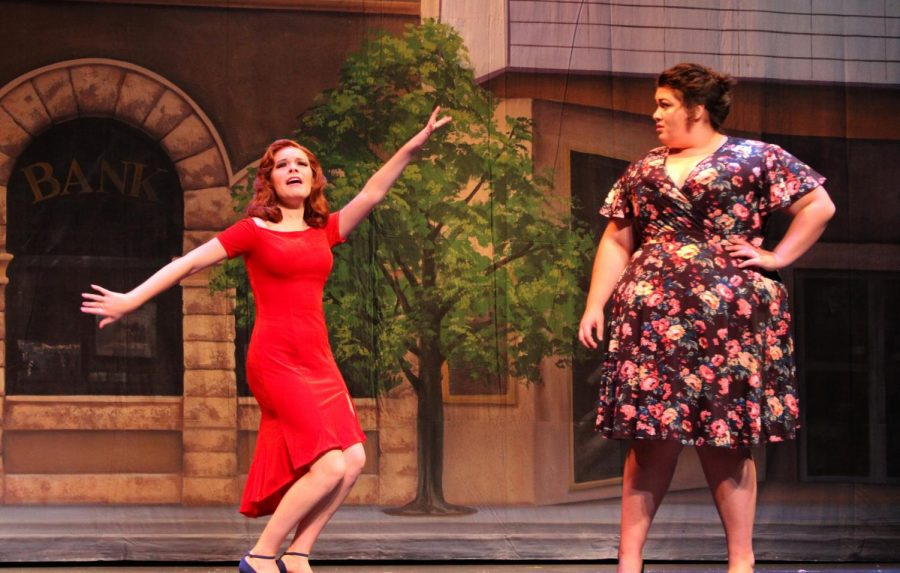 Senior Jessica Schrag shows her character Miss Sandra's personality through her dancing as Sylvia, played by junior Mary Piedrahita, watches her.