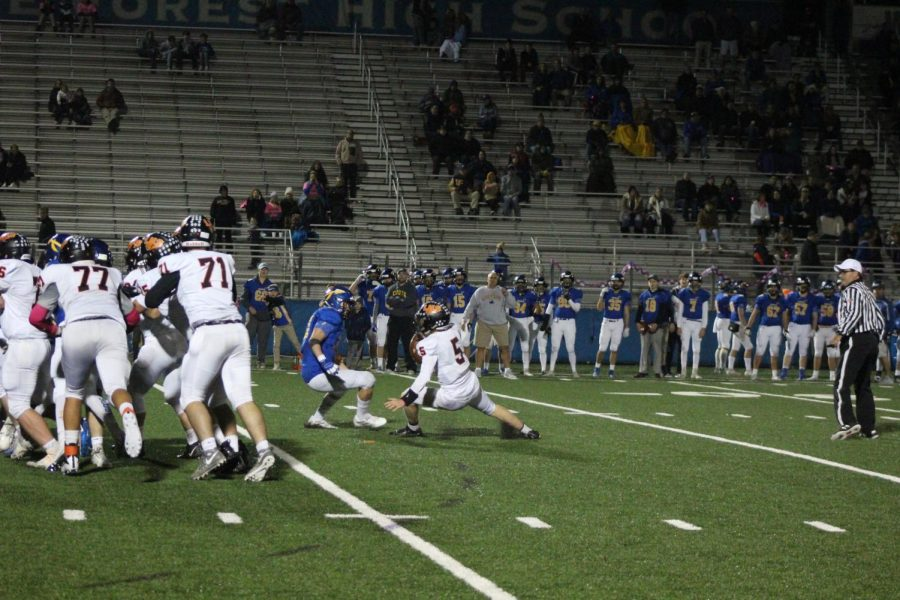 Junior+quarterback+Blake+Ellingson+does+a+circus-like+move+to+escape+pressure+in+the+pocket%2C+before+rushing+for+a+15-yard+gain.