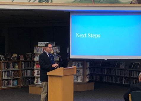 LHS Principal Tom Koulentes presents the next steps for the D128 DARING mission to the Board of Education during its September meeting.