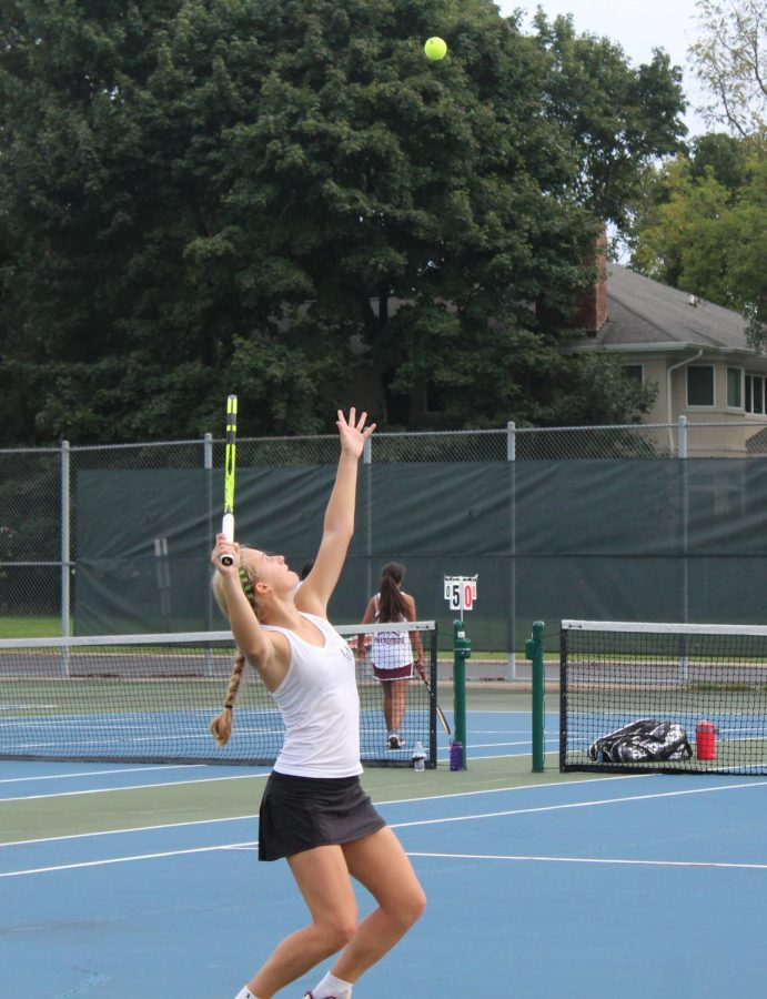 Undefeated freshman singles player Maggie Forkner serves the ball during her last set.
