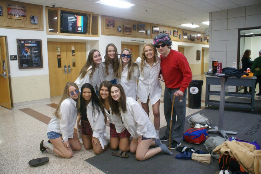 """Every Halloween, the senior girls dress up as Tom Cruise's character from the movie """"Risky Business."""" Senior girls (top row, left to right) Mia Michaels, Abigail Parkerson, Cate Dudley and Maeve Rattin, plus (bottom row, left to right) Ellie Dapier, Erin Custod, Maria Kavathas and Cameron Hamilton dressed up in their Tom Cruise costumes while Joe Mattson dressed in his grandma costume."""