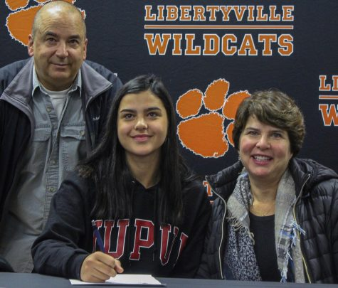 Emma Manolovic, who committed to Indiana University-Purdue University Indianapolis for soccer, poses with her parents.