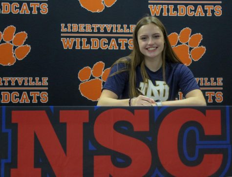 Emma Gleason signs her commitment to University of Notre Dame for swimming.