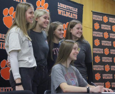 Kristine Kropp, who committed to the University of Detroit Mercy for lacrosse, smiles alongside her friends.