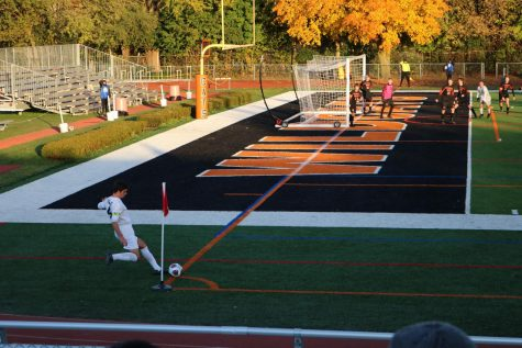 Fremd's team captain shoots a corner kick towards the Libertyville goal while goalie Michael Krukonis (in pink) awaits to try to intercept the ball.