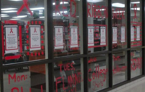 The Friday before Red Ribbon Week started, students decorated the library and cafeteria windows with red paint and informational posters to spread awareness.