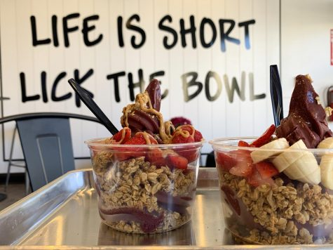 The bowl on the left is the berry bowl, which includes strawberries, blueberries, raspberries, honey and granola with the addition of peanut butter. The bowl on the right is a customized bowl.