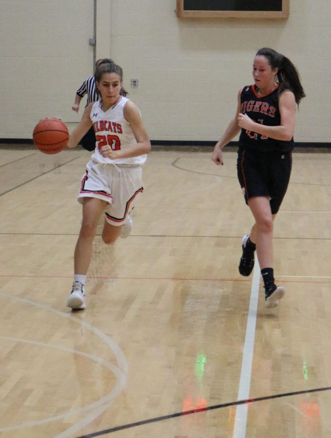 Junior Elise Rodriquez sprints to the offensive side of the court after the Wildcats get a rebound.