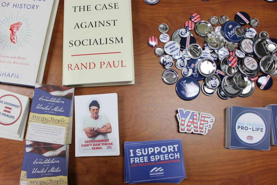 Students who attended the club's first meeting signed in on a table with brochures, books and stickers that align with the club's beliefs.