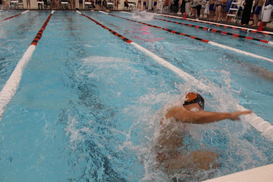 Junior Lawrence Wang does an open turn during his leg of the 200-medley relay.