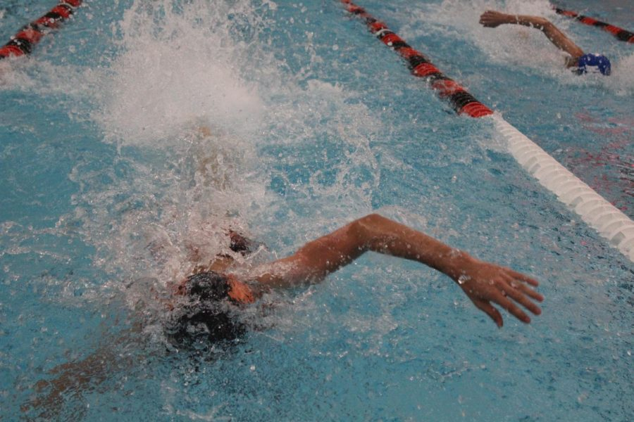 A Libertyville swimmer pulls ahead of an opponent in a freestyle race.