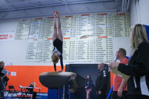 Senior Constance Zanze completes a half-on-half-off during her performance on the vault.