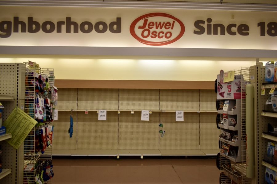 Shelves+that+usually+contain+toilet+paper%2C+paper+towels+and+other+toiletries+were+empty+at+the+Libertyville+Jewel-Osco+on+Sunday%2C+March+15.+