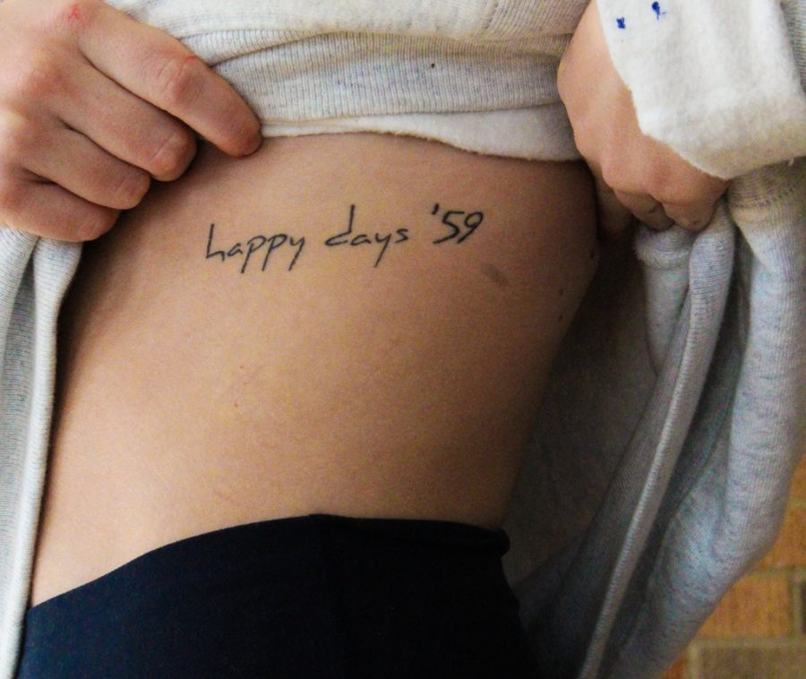 """Senior Allie DeFranco has a tattoo that reads """"happy days '59."""" DeFranco's. tattoo is a tribute to her grandfather and his love for cars."""