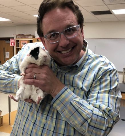Pictured is Dr. David Kreutz holding one of his beloved pets (Photo provided by Dr. Kreutz)