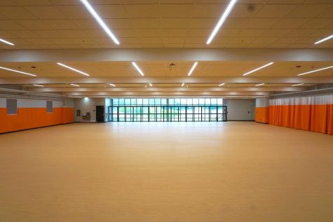 The new wrestling room will be used as a multipurpose room outside of the wrestling season. It is located on the upper level of the old pool space, above the dance studio.