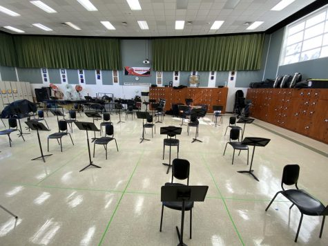 The band room is set up using social distancing precautions, marked by green tape on the floor, to make playing instruments in school safe.