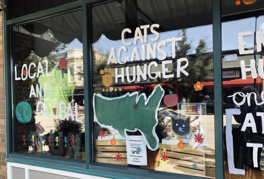 Cats Against Hunger painted their windows with their club's message.