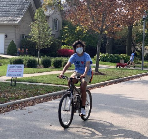 For the launch event, families in Sharma's neighborhood left non-perishable food items at the end of their driveways. Volunteers then went out and collected the food on bikes, wagons and strollers, bringing it to drop-off locations around the neighborhood.
