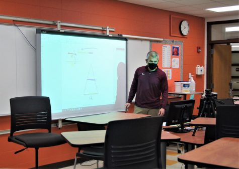 Math teacher Tim Budge teacher from his empty classroom in the LHS building while his students learn from home.