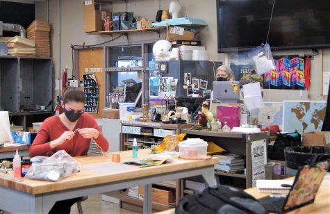 Senior Kylie Miller and art teacher Julie Johnson discuss Miller's AP Art project while staying socially distanced.