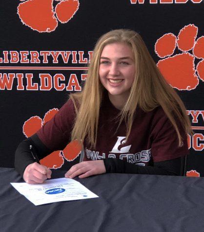 Megan Feeney signs her letter of intent for University of Wisconsin- La Crosse lacrosse.