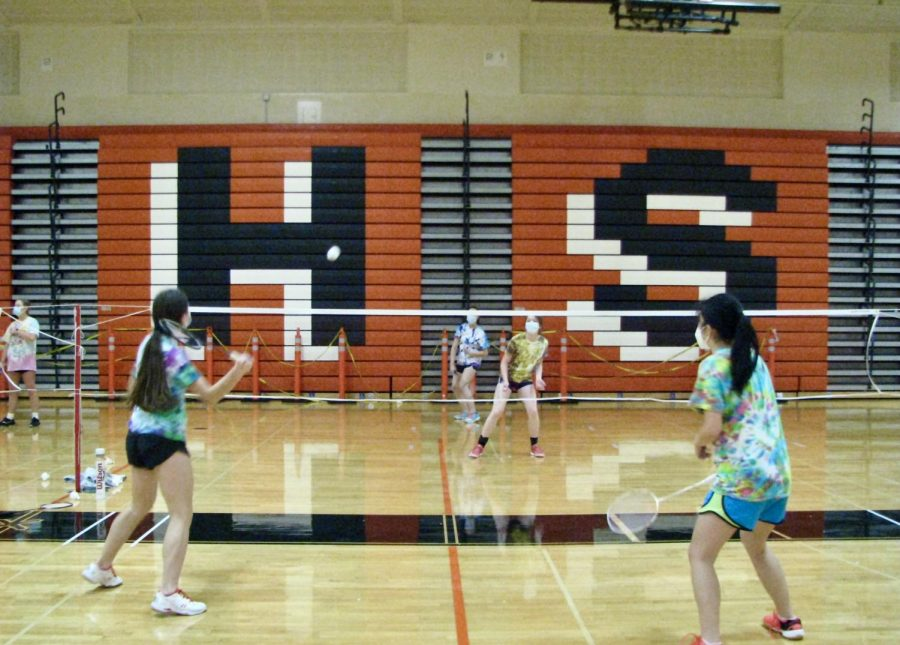 Varsity badminton players start their season with doubles games and COVID-19 precautions.