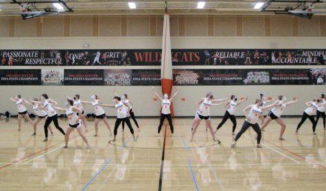 The LHS varsity dance team practice their dances with masks and a new vigor for their season.