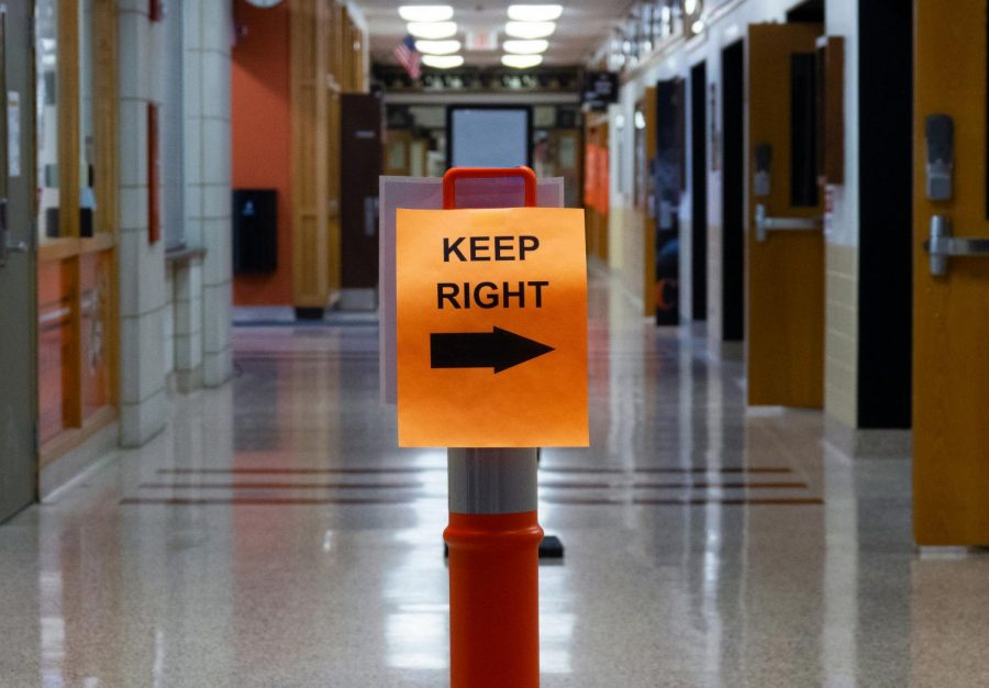Hallways are lined with pylons, clearly marking where students and staff should walk. People must stay on the right side of the hallway to avoid coming into contact with each other.