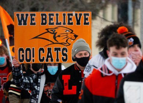 "A group of about 35 LHS athletes marched from Cook Park to LHS, yelling chants such as ""let us play"" in hopes of drawing attention to their cause. Participants waved signs and flags during the march, catching the attention of passing cars."