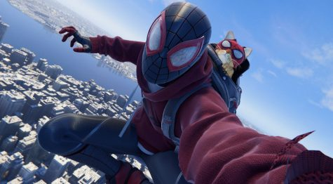 """In """"Spider-Man: Miles Morales,"""" players have the option to dress Miles in a variety of different suits, including this suit known as the """"Bodega Suit."""" With this suit, Spider-Man is aided in combat by a cat named after the titular wall-crawler. In-game screenshot."""