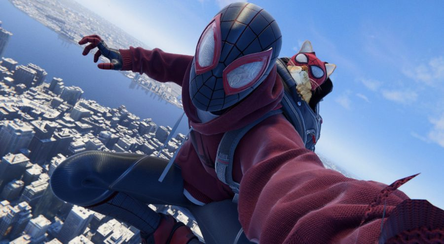 "In ""Spider-Man: Miles Morales,"" players have the option to dress Miles in a variety of different suits, including this suit known as the ""Bodega Suit."" With this suit, Spider-Man is aided in combat by a cat named after the titular wall-crawler. In-game screenshot."