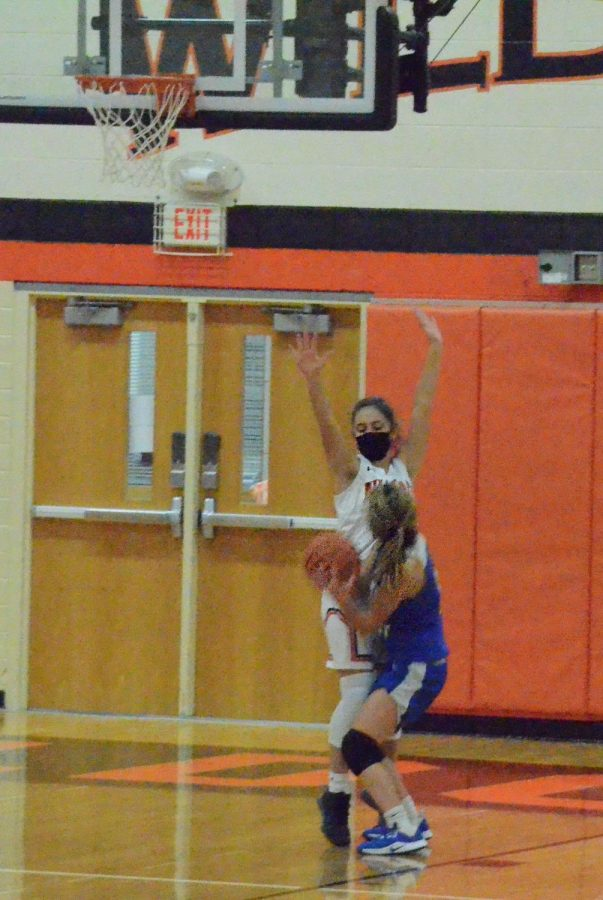Rachel Rule tries to defend the basket, but Lake Forest scores, making the score 44-33.