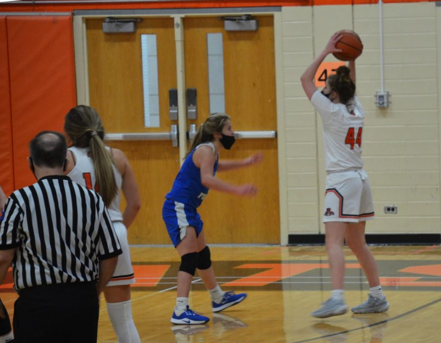 After a missed layup, senior Lauren Huber gets the rebound before passing it to Kate Rule, who made a 3-pointer, making the score 16-8.