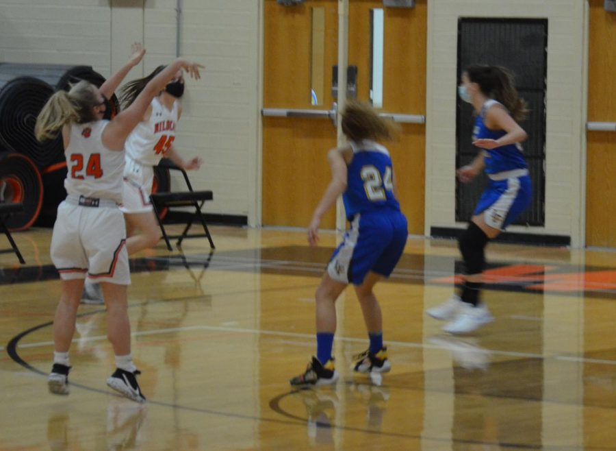 Kate Rule shoots a 3-pointer, making the score 16-8.