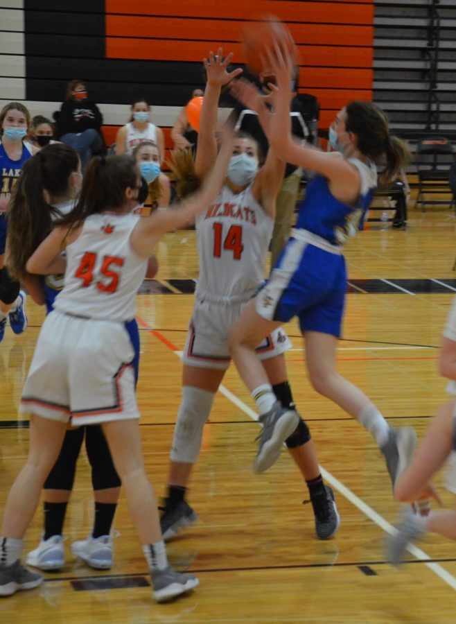 Sarah Larson (45) and Emily Fisher (14) defend the Cats' basket.