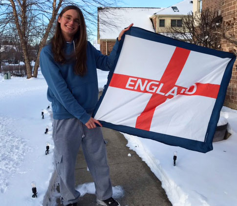 Harry Johnson immigrated from England to the US at the age of eight. He is shown holding the flag that is specific to England instead of the Union Jack which is the national flag of the U.K.