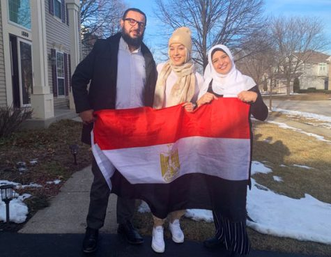 Rofaida Abdel Rahman, pictured in the middle, moved from Egypt, then to Canada, and finally to the U.S.. She and her parents are shown holding the flag of Egypt.