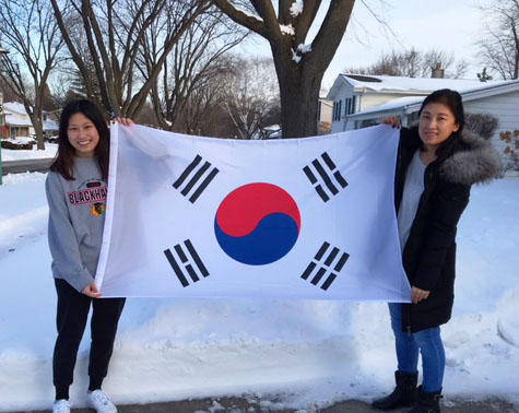 Yelim Na, a junior at LHS, holds the South Korean flag with her mom. Yelim came to the U.S. from South Korea when she was nine years old with her parents.