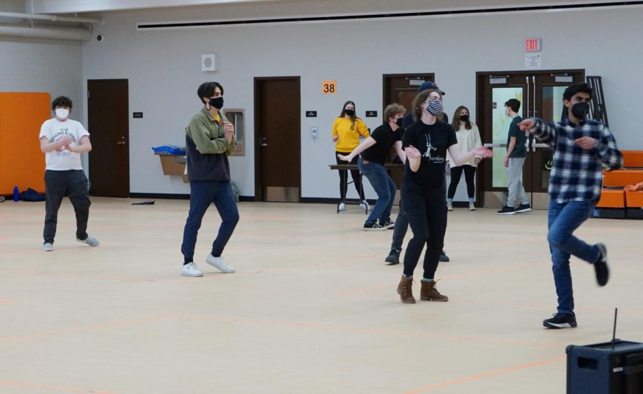 While rehearsing the choreography for the show, the actors still say and act out their lines.