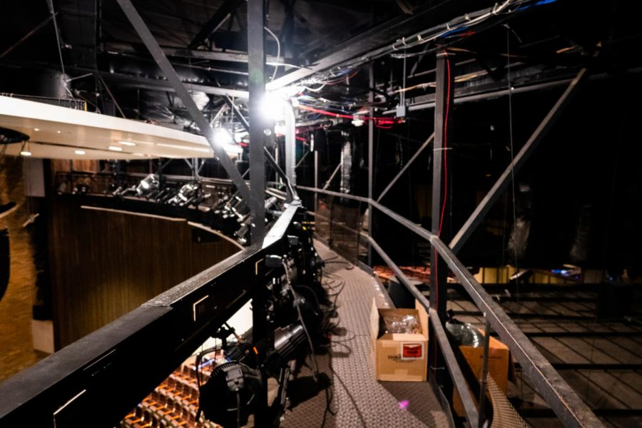 The catwalk above the auditorium stage gives crew members access to spotlights and other special effects. Its high vantage point allows them to spot any technical difficulties and execute the effects as planned.
