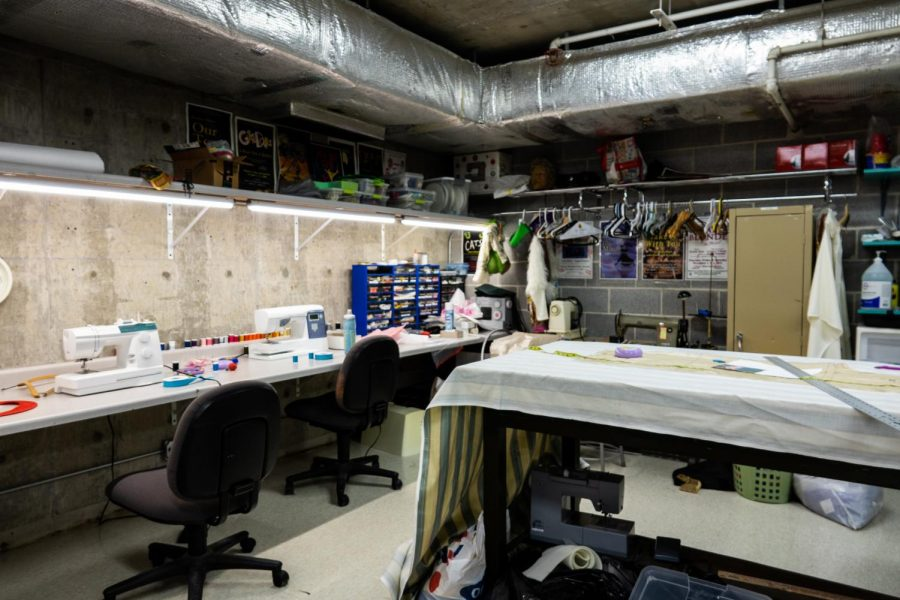 The costume design room underneath the stage is where each production's costumes are made. The room contains sewing kits, measuring tapes, fabric, string and anything else designers need to make costumes.